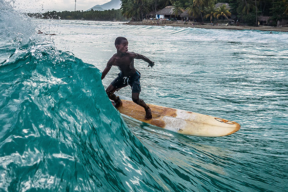Samson, one of the more experienced surfers in the group, catche