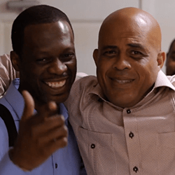 Pras Michel and Michel Martelly pose for camera.