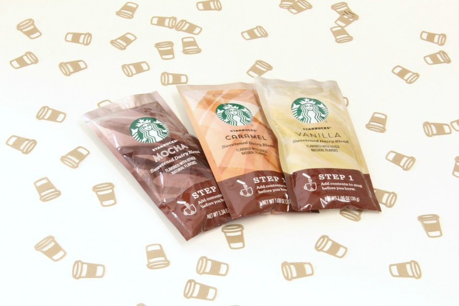 Three of the five flavor packets from the new Starbucks K cup caffe latte