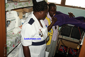 LIONS club of Mulungushi president Enid Sakala shows Chawama clinic sister-in-charge Evelyn Nkhata solar power equipment which was donated to the clininc