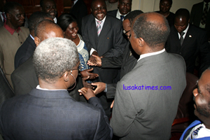 Ministers congratulating each other after taking their oath of office at State House