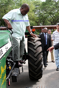PRESIDENT Rupiah Banda after driving one of the tractors donated by the Libyan government. This was at State House during a hand over ceremony
