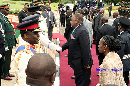 PRESIDENT Banda, trailed by First Lady Thandiwe greeting defence chiefs on arrival.