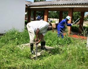 LUAPULA province permanent secretary Jazzman Chikwakwa slashing grass at Twikatane Foundation Centre during a preventive maintenance programme in Mansa