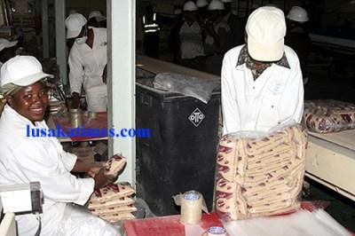 Female workers packing sugar at Zambia Sugar