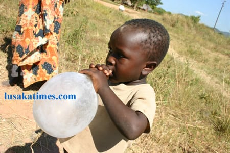FILE: The other side of a condom. A 4 year old boy of Chienge District in Senior Chief Puta's area in Luapula Province playing with an inflated male condom