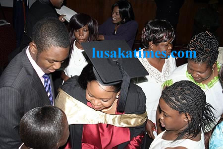 Mrs Mwanawasa with her children after she graduated.