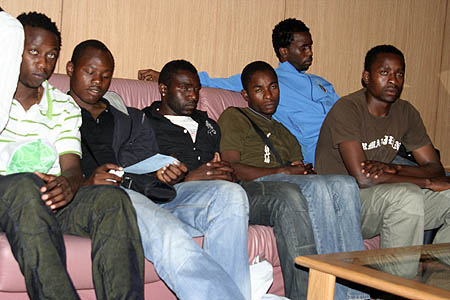 Defeated... National soccer team players on their arrival from Algeria at Lusaka international airport