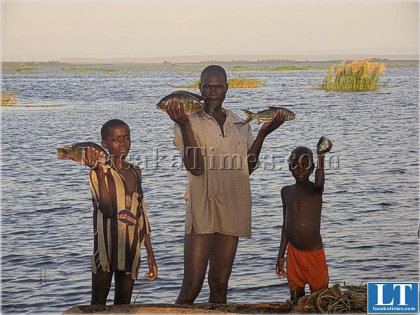 A Sinazongwe fisherman with his children on Lake Kariba
