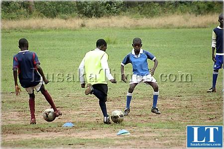 Young boys playing social football at Lusaka club