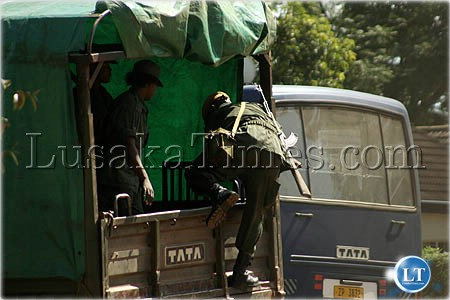 Police transportation...Female police officers disembark from a lorry after a one hour thirty minutes drive from Lusaka to Mazabuka to go and provide security to President Banda and Jacob Zuma