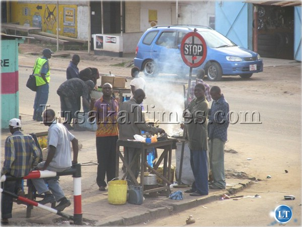 File:Youth conducting business at Mwaisen shopping centre in Chingola township