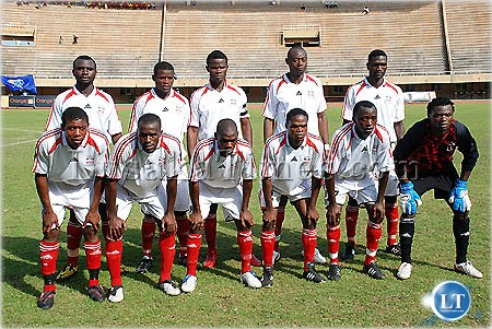 ZANACO Football club squad pose for a picture before taking on Uganda Revenue Authority in kampala