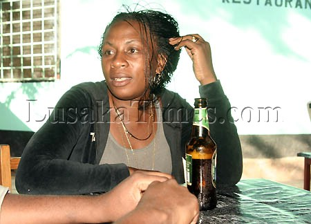 A Mansa woman relaxing over a Mosi lager.