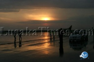 The sun setting over the KK International airport
