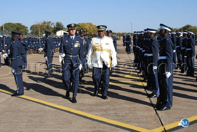 PRESIDENT Banda as Reviewing Officer, and Lt. Col. Collins Barry (r) inspects the Parade mounted by graduating Officer Cadets