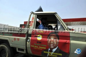 A van with campaign stickers for opposition UPND leader Hakainde Hichilema makes its way along Malambo road in Lusaka