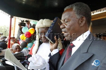 President Michael Sata takes the Oath of Office as Chief Justice Ernest Sakala looks on at the inauguration ceremony in Lusaka