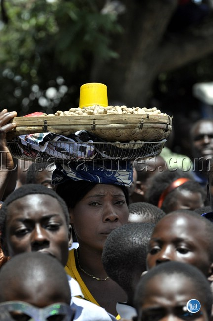 An enterprising youth selling ground nuts on the sidelines of the Youth Day march past