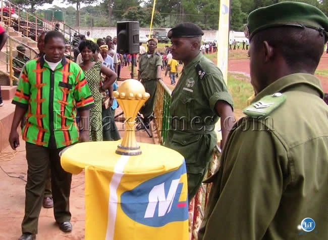 Soccer fans glaring at the AFCON trophy at Kasama Sports Stadium