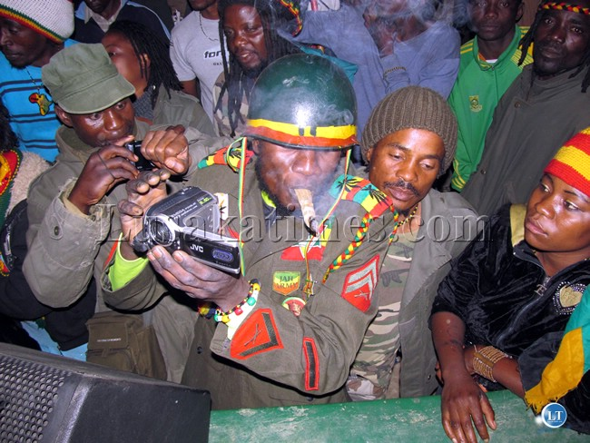 FILE: An amatuer video producer takes time to smoke marijuana during the  Bob Marley Memorial concert in Lusaka west.