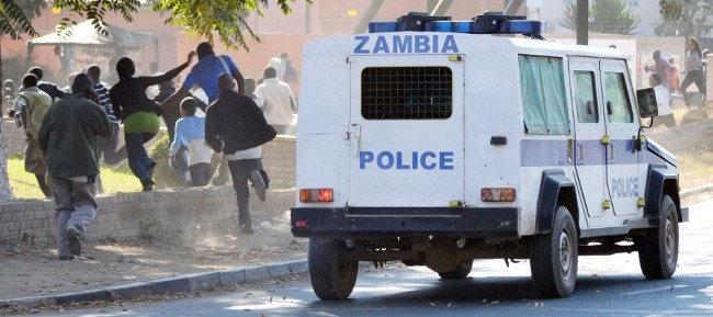 Evelyn Hone College Students running away from Zambia Police riot squad