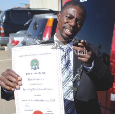 FILE: MMD Mufumbwe Member of Parliament Steven Masumba showing his diploma to the media