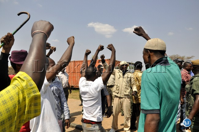 File:PF cadres wielding their party symbol outside the Lusaka magistrate court