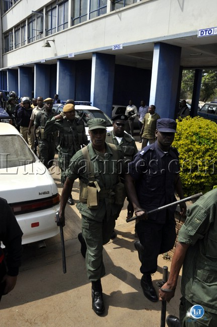 Police officers march to disperse UPND cadres