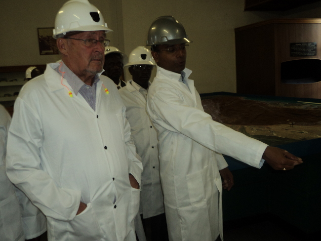 Vice President Guy Scot listening to KCM Chief Executive Officer Jeyakumar Janakaraj during a tour at Nchanga Smelter in Chingola
