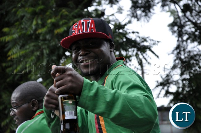 A soccer fan with a specially made Michale Sata cap in a high mood before the Zambia Bukina Faso game