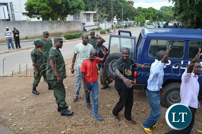 UPND cadres coming out of a police van to appear in Livingstone Magistrate Court