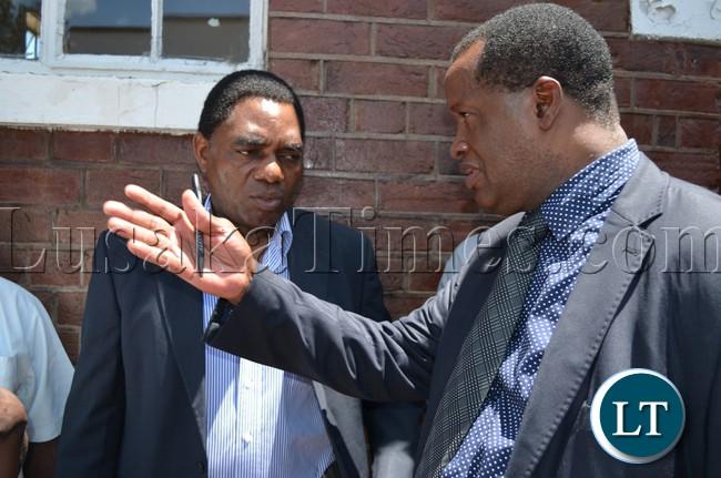 UPND president Hakainde Hichilema (left) interacting with his lawyer Jack Mwiimbu
