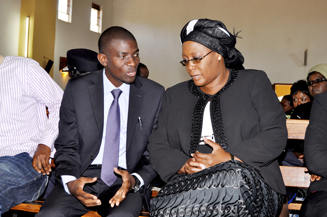 First Lady Dr Christine Kaseba listens to Agriculture deputy minister Greyford Monde Monde during the funeral service of her social secretary Elector Hamwata who died in a road accident opn April 11,2013 at St Mathia's Mulumba Catholic Church in Lusaka's Bauleni Township on April 15,2015