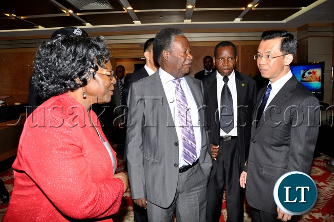 President Michael Sata  with Ministry of Foreign Affairs-African department Director General Lu Shaye (c) nd  Zambia's Ambassador to China Eva Fundafunda (l) at Beijing International Airport shortly before departure to Sanya in China on April 5,2013-Picture by THOMAS NSAMA