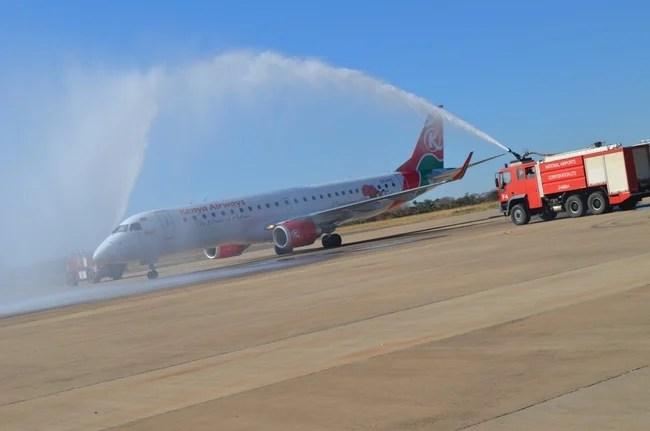 Fire engines splashing water on Kenya Airways aircraft to celebrate the airline's inaugural direct flights on Nairobi-Livingstone route at Harry Mwaanga Nkumbula International Airport in Livingstone