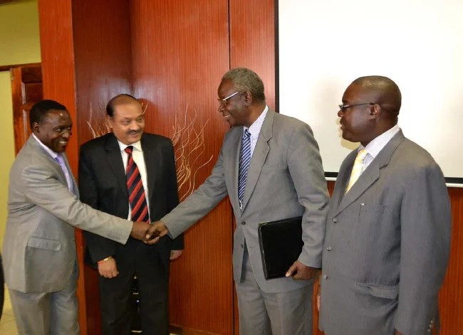 Health Minister Dr Joseph Kasonde congratulates Jaguar Overseas Limited Local Representative Matthew Mwandandila as General Manager Rd Lokhande (second left) and Ministry of Health Permanent Secretary Dr Peter Mwaba look on after the signing ceremony for construction of 650 health posts countrywide