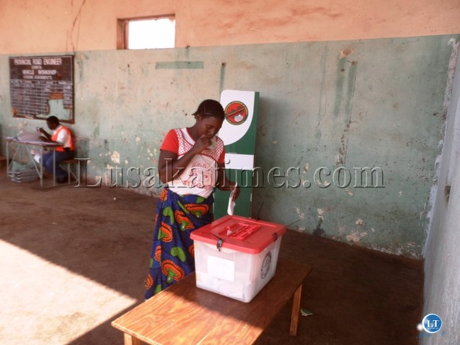 File: A woman of casts her vote in a by-election