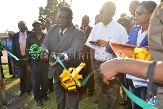 TRANSPORT, Works, Supply and Communication Minister Yamfwa Mukanga cuts a ribbon as he hands over medical equipment to Kamuchanga Hospital donated by Mopani Copper Mines.