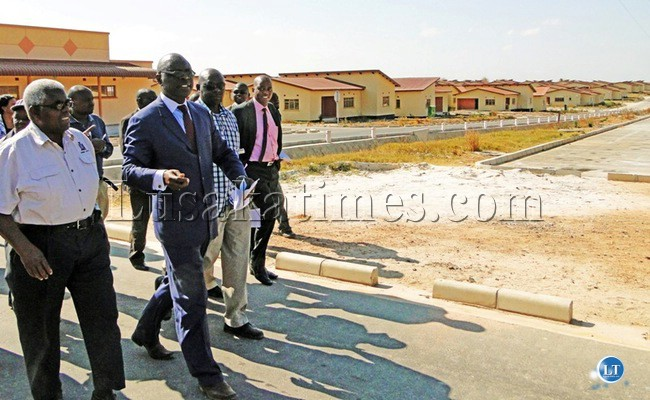 Deputy Secretary to the Cabinet Peter Kasanda during a conducted tour of the KR185 Million NAPSA housing project in Kalulushi.