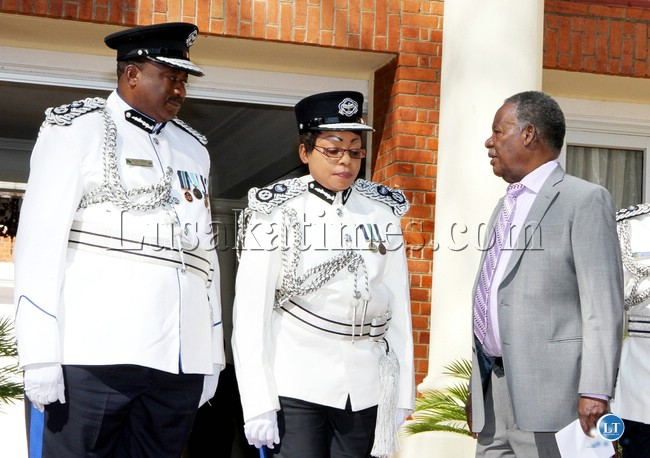 President Michael Sata talks to newly sworn-in- Commissioners of Police Lombe Bwalya-Kamukoshi (c)  and Malcolm Mulenga  during the swearing-in-Ceremony at State House on August 1,2013 -Picture by THOMAS NSAMA