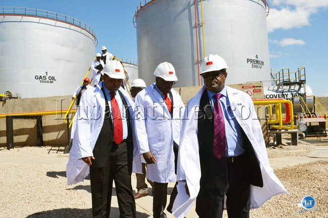 Mines, Energy and Water Development Minister Christopher Yaluma (right) and his Deputy George Zulu (centre) inspect the Lusaka fuel storage depot with Lusaka Province Minister Obvious Mwaliteta before commissioning of the plant