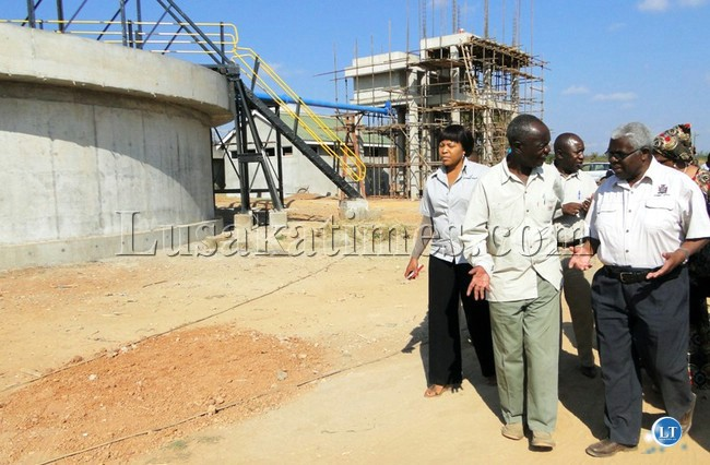 Deputy Secretary to the Cabinet Peter Kasanda (right) and Copperbelt Permanent Secretary Stanford Msichili during a conducted tour of the new Kalulushi water treatment plant under construction by the Chinese.