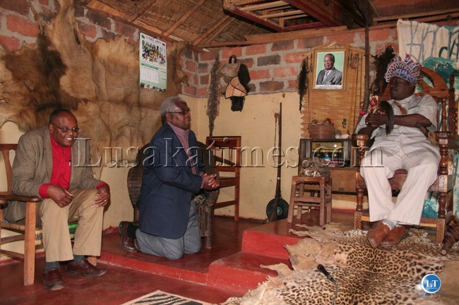 FILE: Deputy Secretary to the Cabinet Peter  Kasanda (Kneeling) with Provincial PS Augustine Seyuba (left) pay a courtesy call on snr chief Kanongesha of the Lunda people at his palace in Mwinilunga.