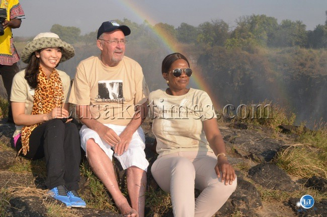 Vice President Guy Scott , Commerce Minister Emmanuel Chenda (left) and Tourism Minister Sylvia Masebo (right) drinking some tea while admiring the Victoria Falls at Livingstone Island