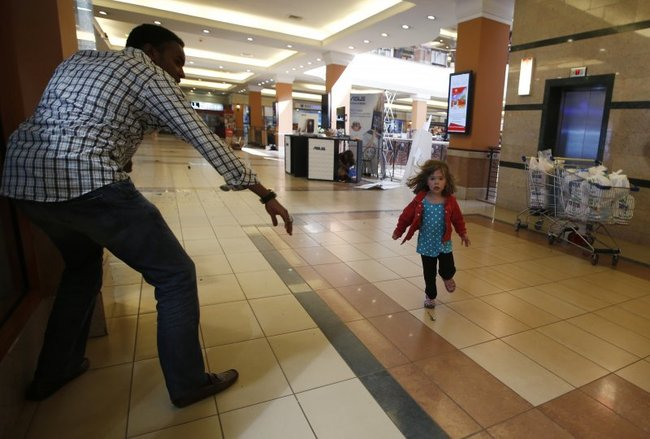 Little girl runs to police during Westgate shopping centre terrorist attack in Nairobi, September 21, 2013.