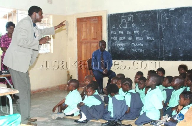 File:The use of local languages as a medium of instruction in schools of lower grades has impressed Government has most learners have responded positively. Here, Education Deputy Minister David Mabumba monitoring the use of icibemba at Ray of Joy Primary School in Nchelenge