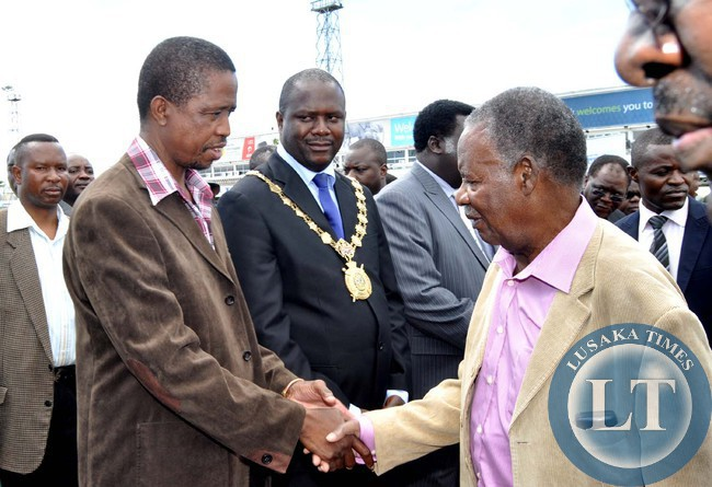 FILE: Late President Sata greets then Defence minister Edgar Lungu