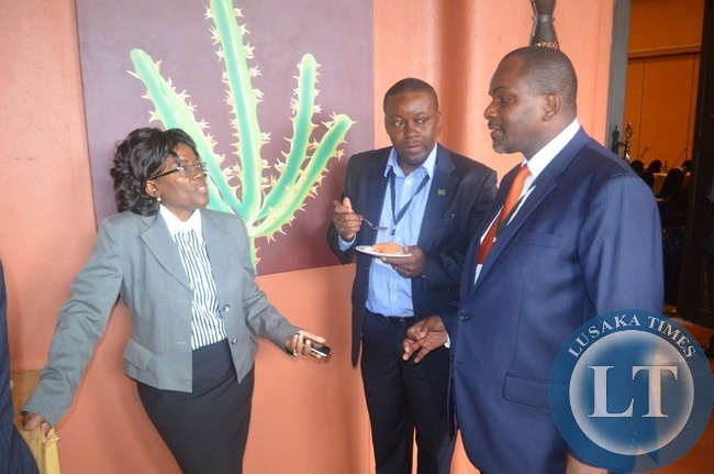Livingstone High Court judge Gaudentia Milimo Salasini (lef) and DPP Mutembo Nchito (right) interacting during the 3rd International Association of Prosecutors (IAP) Conference for the Africa-India Ocean Region in Livingstone at Zambezi Sun Hotel