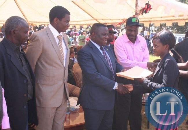 -FOREIGN Affairs minister Harry Kalaba hands over a trophy to Brain Kalenga (r) of Solwezi municipal council for being the best marchers during this year's Labour Day celebrations in Solwezi on Thursday. Looking on is education deputy minister David Mabumba and provincial PF chairperson Fabian Chiposo (l)